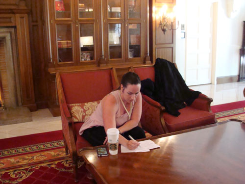 Jill Henley preparing her introduction notes for Thomas Sayles.